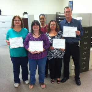 These students have completed the Employer-Based Competency Course. Pictured (L-R) are Tammy Martin, Gail Carroll, Donnis Jamie from the Division of Workforce Solutions, Penny Schwab, and John Schwab