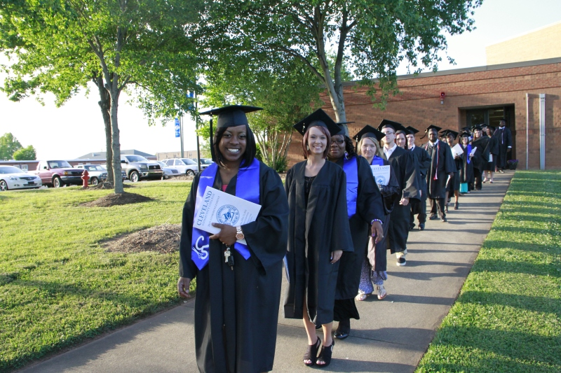 Graduates walking to the amphitheater