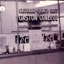 Photo of window showing Cleveland County Unit of Gaston College.
